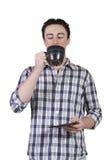 πίνοντας άτομο καφέ που στέ& Στοκ φωτογραφία με δικαίωμα ελεύθερης χρήσης