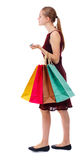 Πίσω άποψη της γυναίκας με τις τσάντες αγορών Στοκ Εικόνα