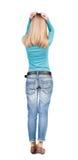 Πίσω άποψη της συγκλονισμένης γυναίκας στο τζιν παντελόνι Στοκ φωτογραφίες με δικαίωμα ελεύθερης χρήσης