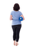 Πίσω άποψη της ώριμης γυναίκας sportswear με τη γιόγκα απομονωμένο χαλί ο Στοκ φωτογραφία με δικαίωμα ελεύθερης χρήσης