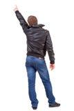 Πίσω άποψη του ατόμου στην υπόδειξη σακακιών. Στοκ εικόνες με δικαίωμα ελεύθερης χρήσης