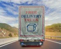 Πίσω άποψη του ελεύθερου εμπορευματοκιβωτίου μεταφορών φορτίου παράδοσης φορτηγών στο δρόμο Στοκ εικόνα με δικαίωμα ελεύθερης χρήσης