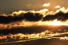 πίσω από το ηλιοβασίλεμα σύννεφων Στοκ Εικόνα