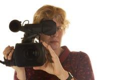 πίσω από το θηλυκό φωτογραφικών μηχανών Στοκ φωτογραφίες με δικαίωμα ελεύθερης χρήσης