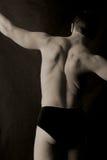 πίσω αρσενικό τέντωμα Στοκ εικόνες με δικαίωμα ελεύθερης χρήσης