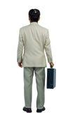 Πίσω γυρισμένος επιχειρηματίας που κρατά έναν χαρτοφύλακα Στοκ Εικόνες