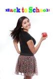 Πίσω κορίτσι σχολικών στο ευτυχές εφήβων με τη Apple Στοκ φωτογραφία με δικαίωμα ελεύθερης χρήσης