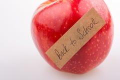 Πίσω στο σχολικό θέμα με ένα μήλο Στοκ εικόνα με δικαίωμα ελεύθερης χρήσης