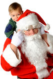 πίσω piggy santa στοκ φωτογραφία