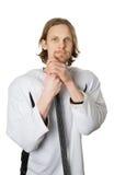 Παίκτης χόκεϋ που κλίνει στο ραβδί Στοκ φωτογραφία με δικαίωμα ελεύθερης χρήσης