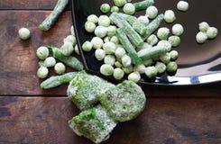 Παγωμένα λαχανικά στο ξύλο Στοκ εικόνες με δικαίωμα ελεύθερης χρήσης