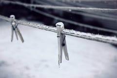 Παγωμένες καρφίτσες ενδυμάτων Στοκ Εικόνες