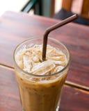 Παγωμένος καφές στον ξύλινο πίνακα Στοκ Εικόνες