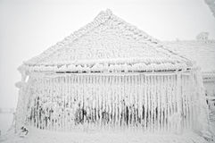 παγωμένος χειμώνας σπιτιών Στοκ Εικόνες