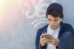 Παιδί με κινητό Στοκ Φωτογραφία