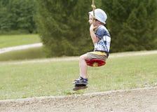 Παιδί στην ταλάντευση Στοκ Φωτογραφίες
