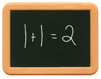 παιδί math το μίνι s πινάκων κιμωλίας στοκ φωτογραφίες