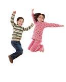 παιδιά ευτυχή πηδώντας μιά φ Στοκ Εικόνες
