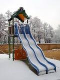 Παιδική χαρά για τα παιδιά κάτω από το χιόνι Στοκ φωτογραφία με δικαίωμα ελεύθερης χρήσης