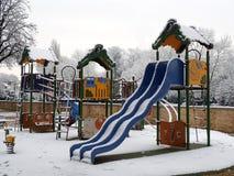 Παιδική χαρά για τα παιδιά κάτω από το χιόνι Στοκ Εικόνα