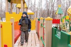 Παιχνίδι αγοριών σε μια παιδική χαρά παιδιών ` s Στοκ εικόνες με δικαίωμα ελεύθερης χρήσης