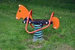 παιχνίδι s πάρκων χλόης εξοπλισμού παιδιών Στοκ εικόνα με δικαίωμα ελεύθερης χρήσης
