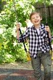 Παιχνίδι αγοριών στην παιδική χαρά Στοκ εικόνες με δικαίωμα ελεύθερης χρήσης