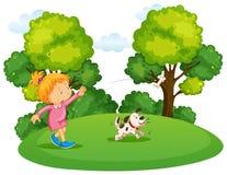 Παιχνίδι κοριτσιών με το σκυλί κατοικίδιων ζώων στο πάρκο απεικόνιση αποθεμάτων
