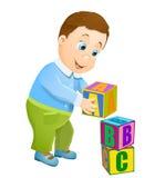 Παιχνίδι μικρών παιδιών με τους κύβους αλφάβητου abc Στοκ Εικόνες