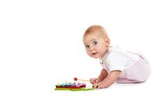 Παιχνίδι μωρών με τα μουσικά παιχνίδια Στοκ Φωτογραφία
