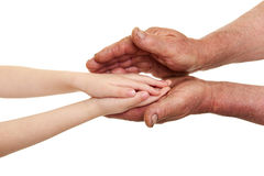 Παιδί και παλαιά χέρια ατόμων Στοκ Εικόνες