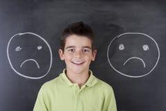 Παιδί με τις εκφράσεις στοκ φωτογραφία