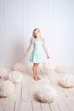 Παιδί με τις διακοσμήσεις στο λευκό Στοκ Φωτογραφίες
