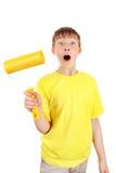 Παιδί με τον κύλινδρο χρωμάτων Στοκ εικόνα με δικαίωμα ελεύθερης χρήσης