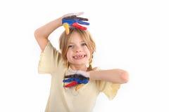 Παιδί με τους χρωματισμένους φοίνικές της στοκ εικόνες