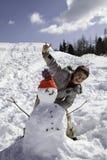 Παιδί με το χιονάνθρωπο Στοκ Φωτογραφία