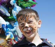 Παιδί με το χρωματισμένο πρόσωπο Στοκ Εικόνες