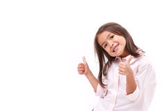 Παιδί που δίνει δύο αντίχειρες επάνω Στοκ Εικόνες
