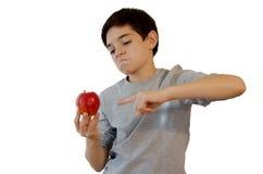 Παιδί που δείχνει τη Apple Στοκ Εικόνες
