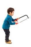 Παιδί που χρησιμοποιεί το πριόνι Στοκ Εικόνες