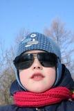 Παιδί στα σκοτεινά γυαλιά Στοκ Εικόνες