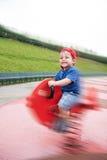 Παιδί στην άνοιξη παιδικών χαρών Στοκ Φωτογραφία