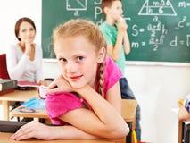 Παιδί σχολείου με το δάσκαλο. Στοκ Φωτογραφία