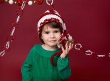 Παιδί Χριστουγέννων στο καπέλο νεραιδών Santa στοκ εικόνες με δικαίωμα ελεύθερης χρήσης