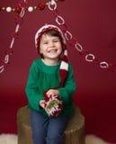 Παιδί Χριστουγέννων στο καπέλο νεραιδών Santa στοκ φωτογραφίες με δικαίωμα ελεύθερης χρήσης
