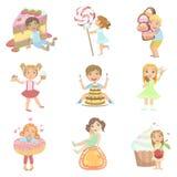 Παιδιά και γιγαντιαία γλυκά καθορισμένα Στοκ εικόνα με δικαίωμα ελεύθερης χρήσης