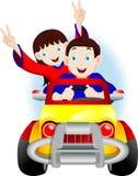 Παιδιά που οδηγούν ένα αυτοκίνητο Στοκ Εικόνες