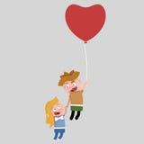 Παιδιά που ταξιδεύουν σε ένα μπαλόνι καρδιών Στοκ Φωτογραφίες