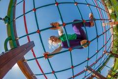 Παιδιά στην παιδική χαρά Στοκ εικόνα με δικαίωμα ελεύθερης χρήσης