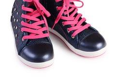 Παιδιών ` s πάνινα παπούτσια που απομονώνονται μοντέρνα στο λευκό Στοκ εικόνες με δικαίωμα ελεύθερης χρήσης